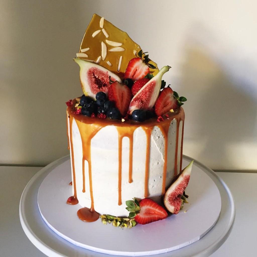 vanilla cake topped with caramel drip - 123WeddingCards