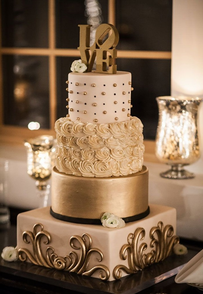 wedding cake with a golden bottom tier