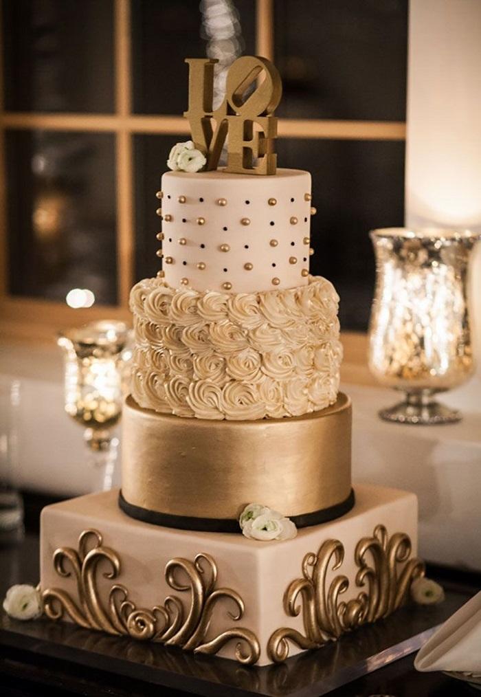 wedding cake with a golden bottom tier