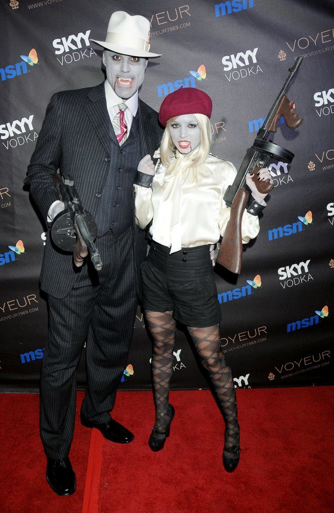 Halloween dress of Rick Fox and Eliza Dushku in 2009