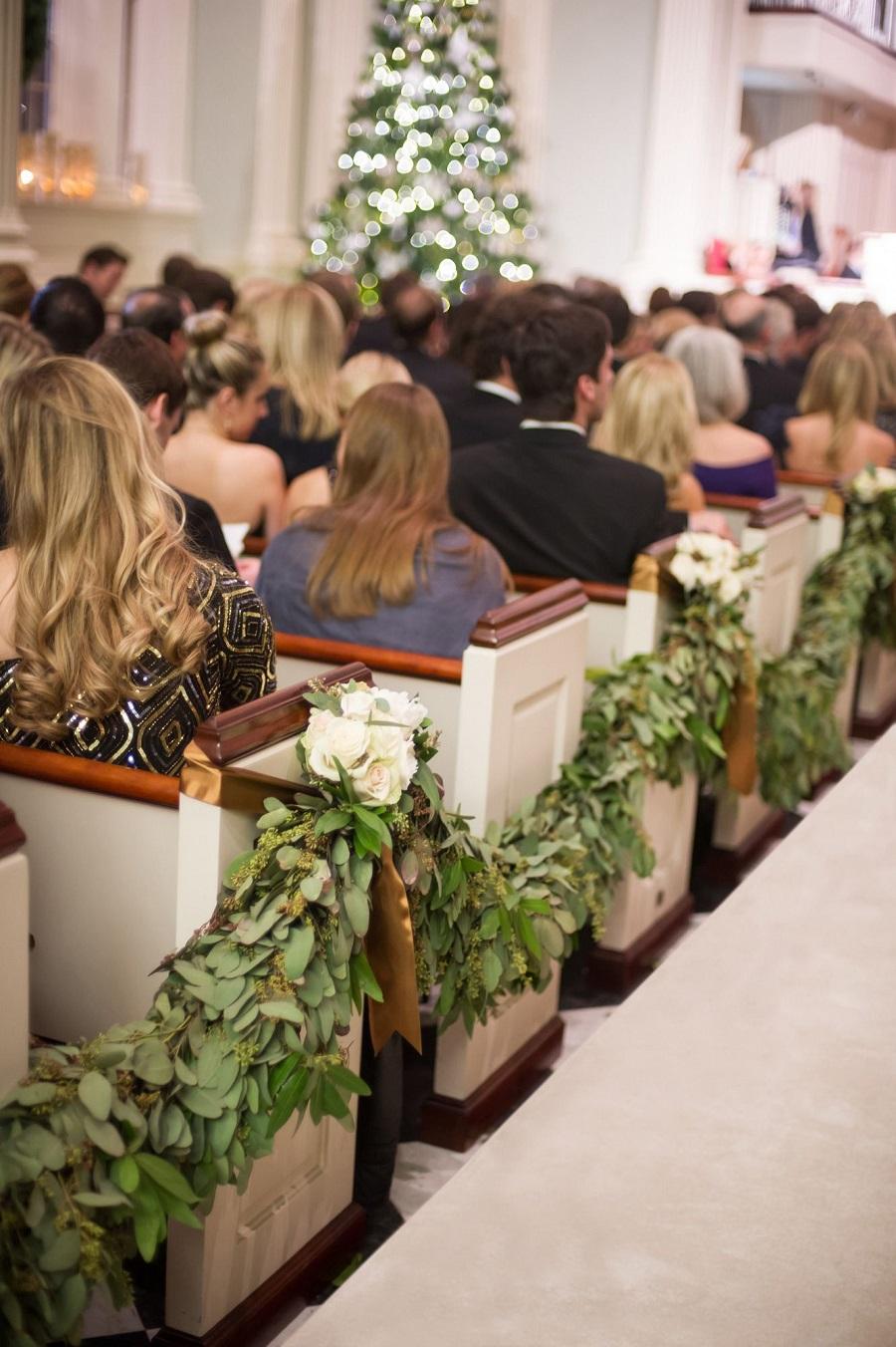 garland strategically draped and candles at Church - 123WeddingCards